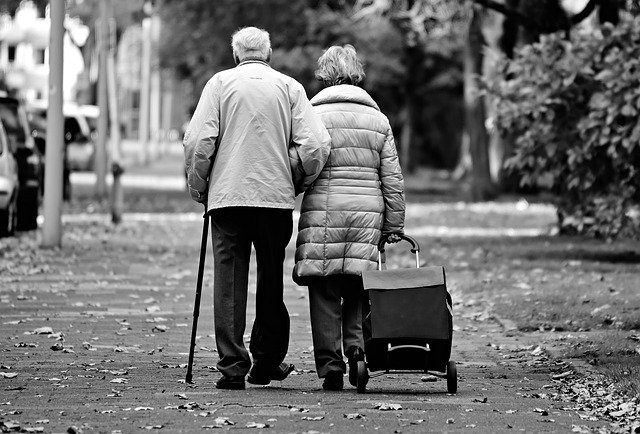 Couple seniors walking